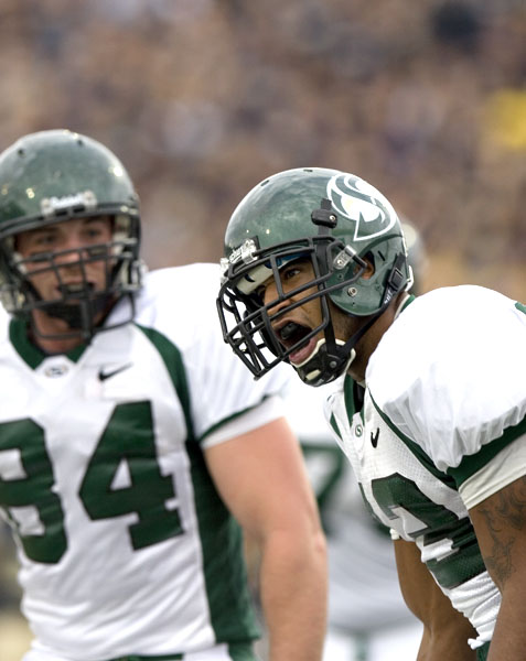 Hornet Tony Washington pumps up his teammates after scoring a first half touchdown against the UC Davis Aggies in the 55th Annual Causeway Classic. The Hornets went on to defeat the Aggies 29-19 ending an 8 game losing streak dating back to 1999.: