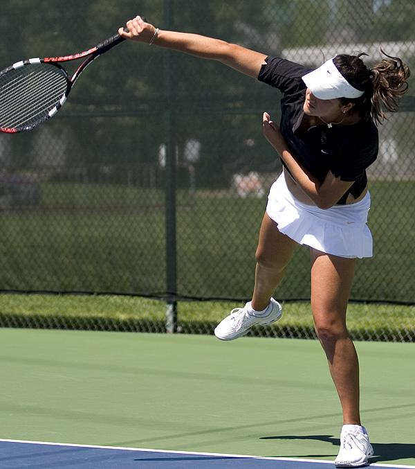 Clarisse Baca smashes the ball down the middle of the court for a point against UOP in a team match on Saturday.: