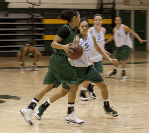 Guard Tika Koshiyama-Diaz defends teammate Ashley Garcia during practice at the Hornets Nest.: