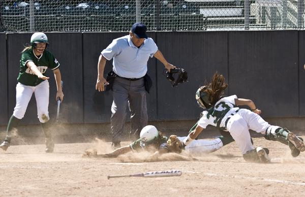 Bartee slide:Senior Jenice Bartee slides into home just a moment too late as the Colorado State catcher tags her out during the third inning.:Tina Horton State Hornet