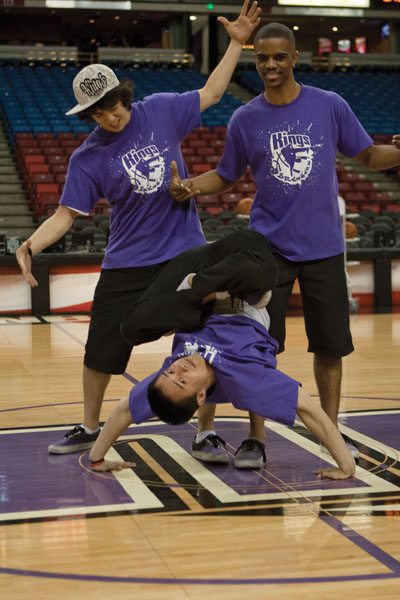 Kings Breakers:The offical Kings Break Dancing team, the King Breakers, warm up before a performance Friday. Sac State students Kurt and Vince Horiuchi (left; center) and Jayson Shaw (right) are members of the team.:Julie Keefer - State Hornet
