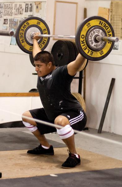 Weight lifting:Student Marco Montano Jr. does squats during weightlifting club practice.:Tina Horton State Hornet