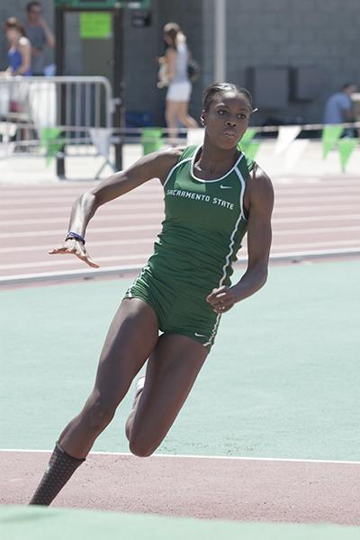 Robinson high jump:Track and field star Moira Robinson sprints toward the bar during the high jump Saturday at the Sacramento State Open.:Robert Linggi State Hornet
