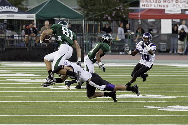 Deadder vs. Weber State:Wide reciever Chase Deadder jumps to avoid being tackled during a game against Weber State on Saturday night at Hornet Field. The Hornets won 24-17.:Robert Linggi - State Hornet