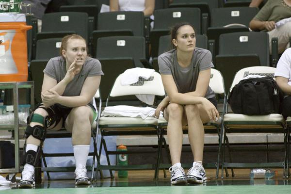 injuries:Injured players Maddison Thivierge (right) and Hannah Hettinga (left) cheer on the team from the sidelines.Thivierge is still named co-captain despite being injured.:Brittany Bradley - State Hornet