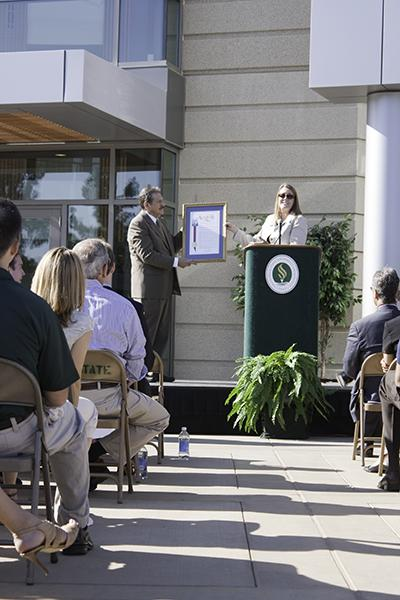 The Well grand opening 1:California State Assembly woman Alyson Huber presents a California State Assembly Resolution to President Gonzalez to commemorate The Well's opening.:Rachel Lotz - State Hornet