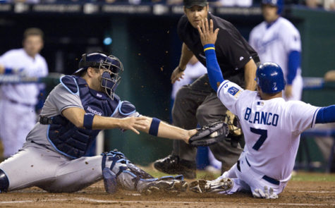 Double Coverage baseball:Kansas City Royals' Gregor Blanco (7) scores as Tampa Bay Rays catcher Kelly Shoppach (10) tries to reach him with the tag in the first inning at Kauffman Stadium in Kansas City, Mo., on Friday.:John Sleezer/Kansas City Star - MCT