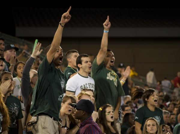 greenarmy2:Members of the Green Army celebrate after a big play. :Mayra Romero - State Hornet