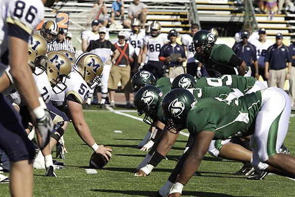 Football vs. Montana State 1:Hornets and Bobcats line up for a play during today?s Big Sky Conference game at Hornet Stadium. Montana State won 64-61 in overtime.:Robert Linggi - State Hornet