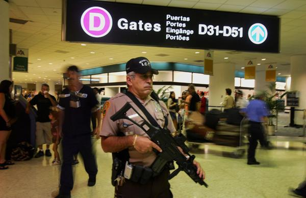 airport security:Miami Dade Police officer Mark Huetter walks the concourse at Miami International Airport.:McClatchy Tribune
