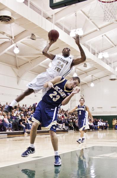 Men's basketball comes up short 61-54 against Davis :Hornets? forward Zach Nelson flies over his opponent Josh Ritchart and adds two more points to the scoreboard. The game was against UC Davis and ended with a loss for Sac State with a final score of 61-54. :Ashley Neal - State Hornet