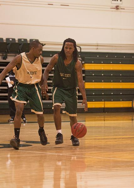 mens basketball 1:Antoine Proctor dribbles around the defender during practice.:Daniel Ward - State Hornet