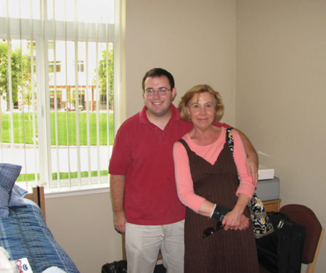 Scott Hawkins :Scott Hawkins poses with his mother Elizabeth Hawkins during move-in day at the American River Courtyard residence hall.:Courtesy Photo