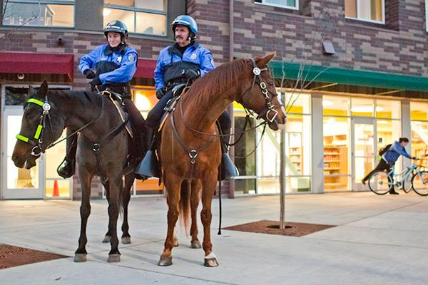 Police officers on horses:Sgt. Lisa Maneggie and officer Bill Lyons patrol the campus. :Nicole Lundgren - State Hornet