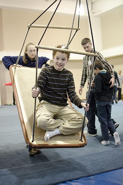 Volunteer pushes autistic child on swing:Volunteer Mandy pushes Will on a swing during a volunteer program for children with autism set up by professor Scott Modell in Solano Hall.:Robert Linggi - State Hornet