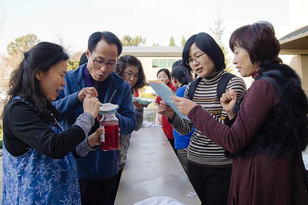 South Korean student teachers:From left to right: Teachers Park Soonok, Ha Namchil, Choi Soonok and Kim Sungmi from Chinju University in South Korea, take a break from class to make ice cream.:Robert Linggi - State Hornet