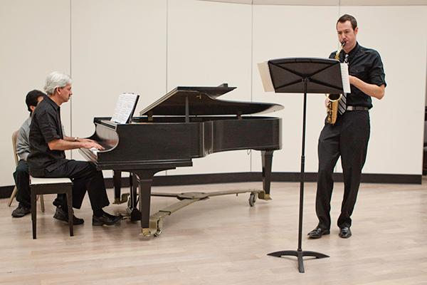 Cozza 1:Campus accompanist John Cozza practices with saxophonist Keith Bohm during a rehearsal in August.:File photo
