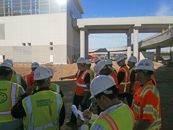 CMSA construction:The Construction Management Student Organization sets up plans for a construction project.:Courtesy photo