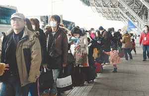Going home Japan::Photo courtesy of McClatchy Tribune