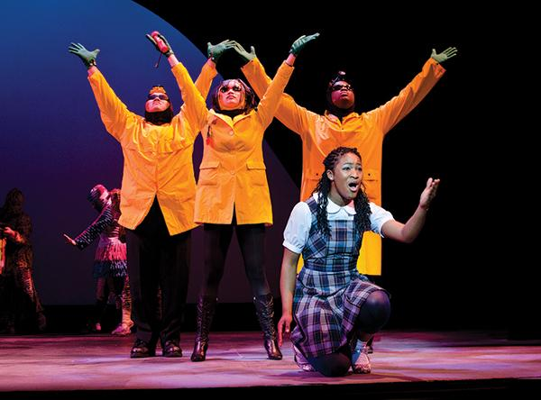 The Wiz: Dorothy, played by theater major Ashli Fisher, sings during one of the main musical numbers ?Soon as I Get Home.? The yellow figures behind her represent the Yellow Brick Road. :Robert Linggi - State Hornet
