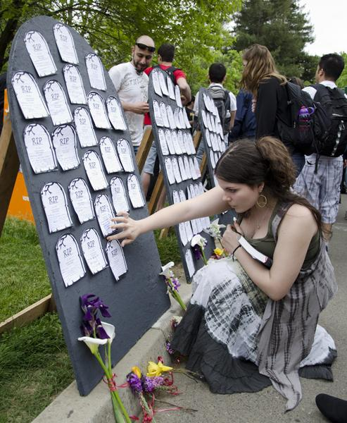 Student posts message on gravestone:Freshman Natalie Defazio posts her memorial message on a gravestone in the Library Quad. Defazio is worried she may have to leave Sacramento State if her classes are canceled due to budget cuts.:Steven Turner - State Hornet