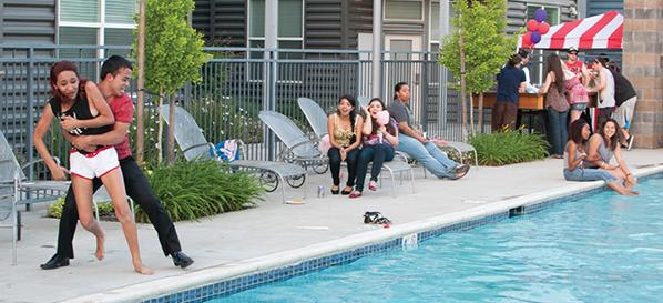 Daniel Fernandez tosses Vanessa Segura into the pool at the Upper East side lofts student housing.  Thursday Upper East Side lofts threw a party where these two horsed around.  Daniel is a criminal justice major and Vanessa is a psychology major while both are juniors.