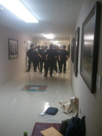 Police in riot gear at Sacramento Hall:Police in riot gear stand in Sacramento Hall in preparation of removing students.:Courtesy of sit-in organizers