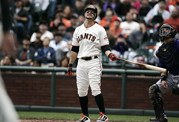 San Francisco Giants Cody Ross (13) reacts to a foul ball that was caught for an out against the Colorado Rockies in the third inning at AT&T Park in San Francisco, California, on Saturday, June 4, 2011. The Rockies beat the Giants 2-1. (LiPo Ching/San Jose Mercury News/MCT)