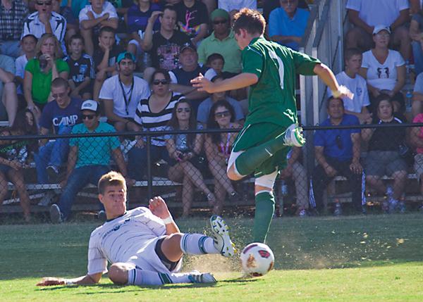 Matt Linenberger does a slide kick to steal the ball away. Last season, he scored two goals as a defender.