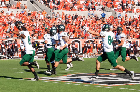 Sacramento State football players storm the field at Reser Stadium on Saturday after their historic 29-28 overtime victory against Oregon State.