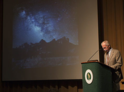 Dr. Dale Russell, an adjunct professor, begins the STEM Scholars Lecture: Worlds to Discover, Exploring the Galaxy for Dinosaurs with an image of the Milky Way on Tuesday.