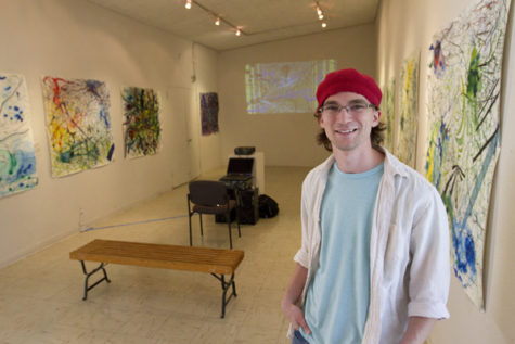 "Senior studio art major Alex Booze prepares to greet visitors at the Witt Gallery Monday, with a reception to see his work, ""New Wave"" by Alex Booze."