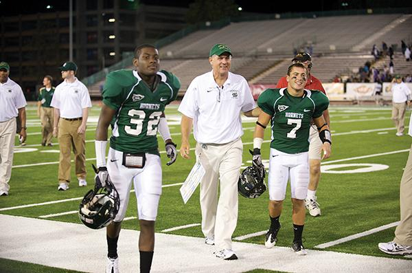 From left to right: DB Osagi Odiase, head coach Marshall Sperbeck, DB Kyle Monson.