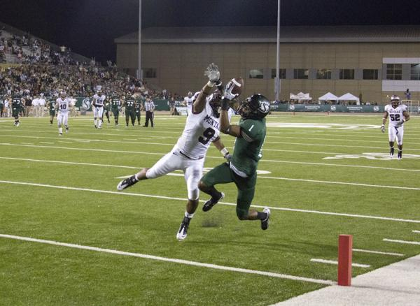 WR Brandyn Reed leaps for the touchdown catch against Montana.