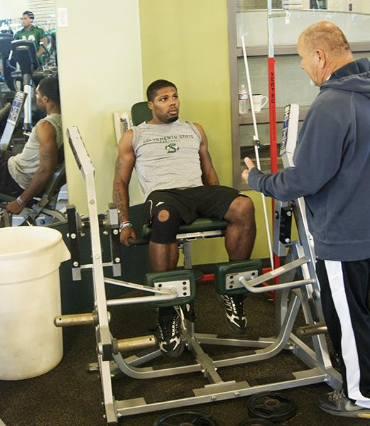 Hornets running back Curtis Shaw is listening keenly to trainer Joe Ramos' instructions.