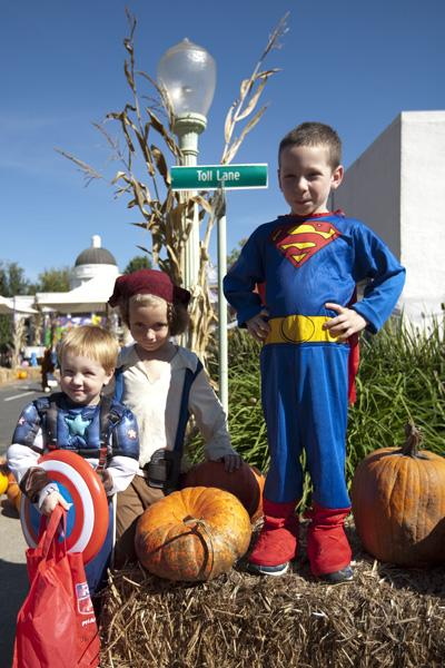 Super heroes Damian (left), Ashton (center) and Christopher (right) gathered at the corner of Toll Lane and Main Street in Safetyville on Saturday.