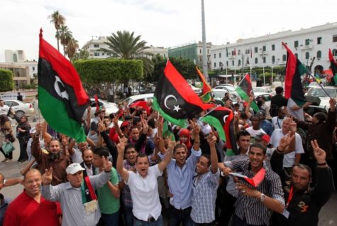 Libyans celebrate on the streets after the death of Moammar Gadhafi.