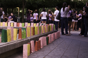 Sac State students prepare the luminary display in the Library Quad on Thursday. The event was hosted by Alpha Chi Omega to help raise domestic violence awareness.