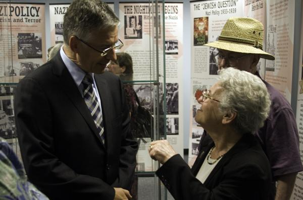 Denis Doute, CEO of the Societe Nationale des Chemins de francais, and Holocaust survivor Liz Igra have a conversation within the exhibit shortly after the gallery's ceremonial opening on Sept. 20.