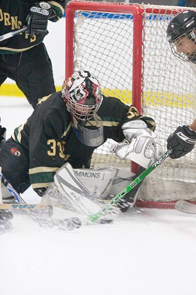 Goaltender Tim Kesner makes a save for the Hornets at Skate Town in Roseville.