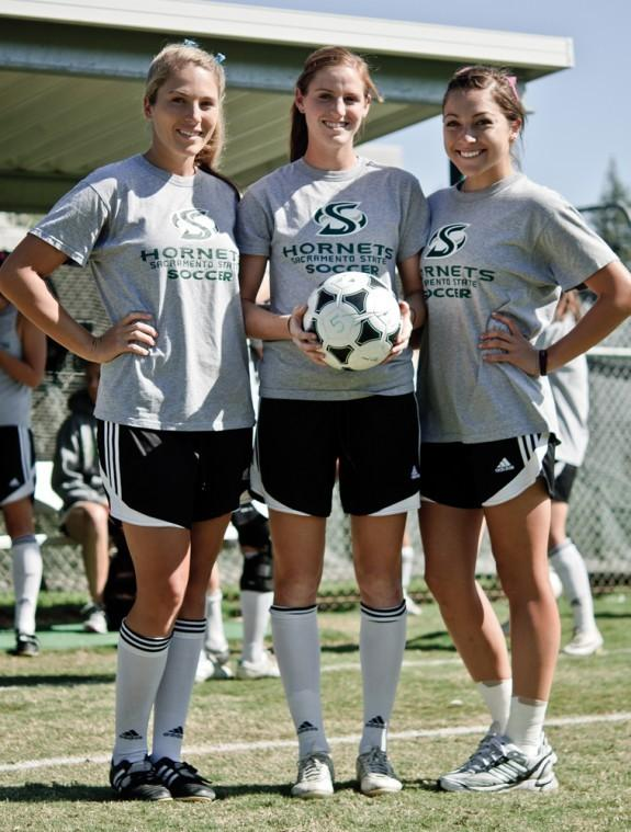 From left to right: Paige Tucker, Shea Roberts and Lauren Garcia are playing their final season together as Hornets.