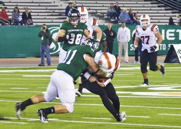 Junior linebacker Jeff Badger makes a tackle during the first half of Saturday's game against Idaho State.