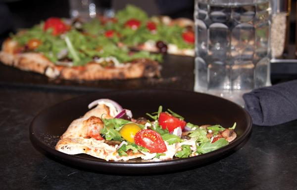 A slice of vegan pizza from Hot Italian was one of the entries in the Vegan Chef Challenge.