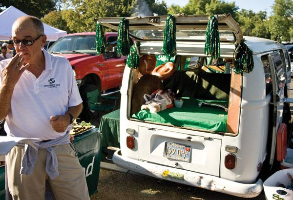 A Sacramento State football fan gathers in the parking lot to enjoy his tailgating experience.