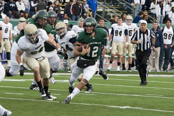 Freshman quarterback Garrett Safron runs against UC Davis during the 58th Causeway Classic at Hornet Stadium on Saturday.