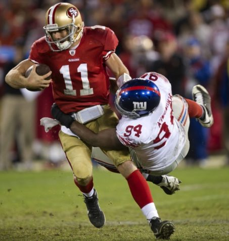 New York Giants outside linebacker Mathias Kiwanuka (94) grabs San Francisco 49ers quarterback Alex Smith (11) in the fourth quarter of their NFC Championship game at Candlestick Park in San Francisco. (Hector Amezcua/Sacramento Bee/MCT)