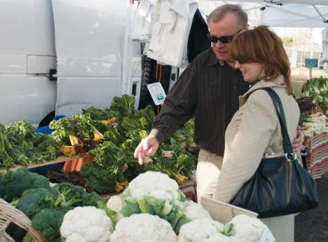 Customers browse the selection of produce from Rio de Parras Organics in the Carmichael Park farmers market.