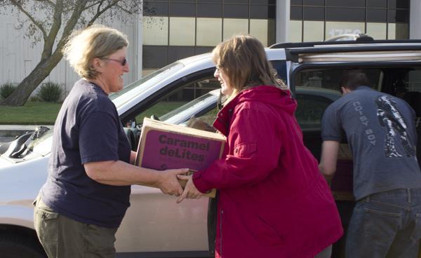 Volunteers help load cookies in to vehicles Saturday at the 2012 cookie drop.