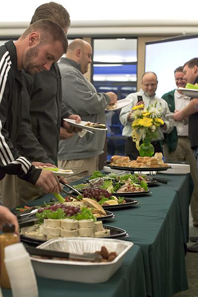 Sacramento State booster members and the football staff gather to enjoy food and drinks in the Alumni Center on Wednesday, football's signing day.