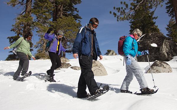Sac State students and alumni trek through the snow at Echo Summit during Peak Adventures' snowshoeing trip.